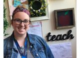 Katie Bradley standing in front of bulletin board